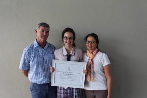 Kate is pictured with her proud parents, Terry and Maree Wilcox.
